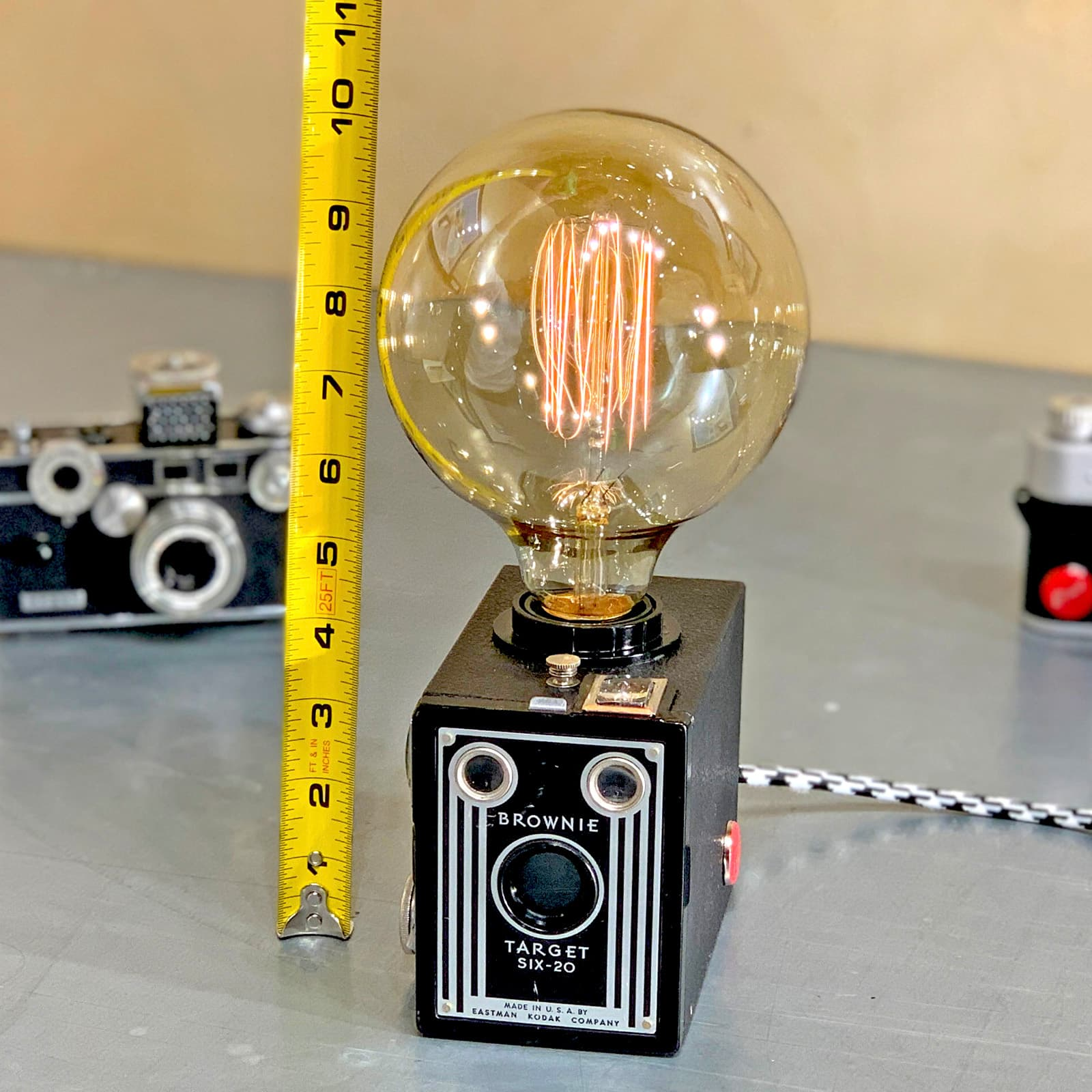 Showing measurements using measuring tape of Rosie's Workshop original vintage camera accent light - the Kodak Brownie Six-20, the original point & shoot camera. All parts are UL component listed (c UR us) for United States and Canada.
