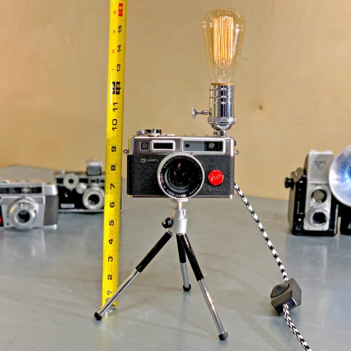 Showing measurements using measuring tape of Rosie's Workshop original vintage camera accent light - the Yachica E35, the Spider Man Camera. All parts are UL component listed (c UR us) for United States and Canada.