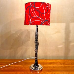 Rosie's Workshop original clarinet table light with red and black swirl lamp shade. All parts are UL component listed (c UR us) for United States and Canada.