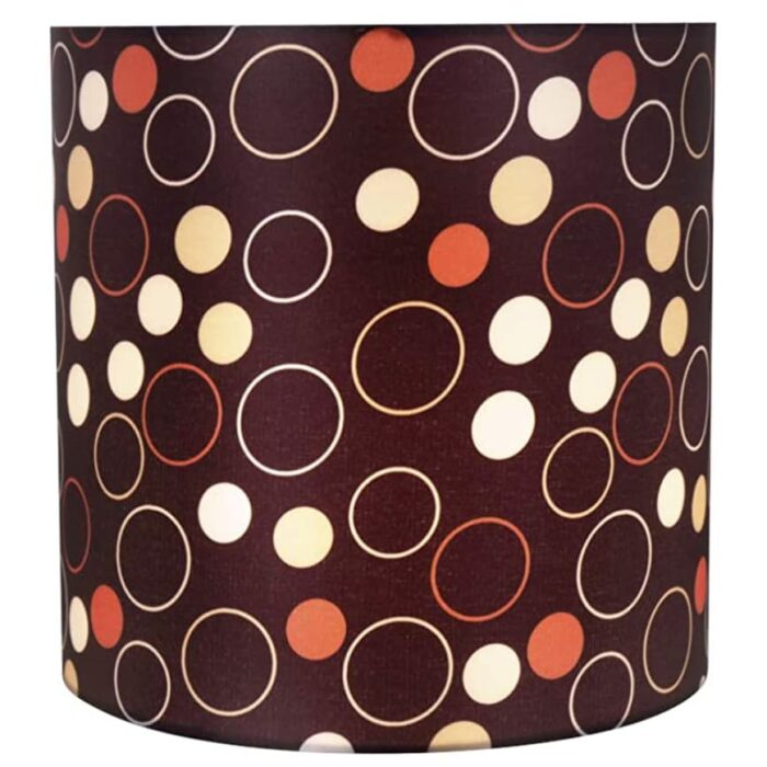 "View of Aspen Creative 8""x8""x8"" black, white, red lamp shade lit."