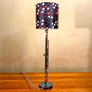 Back view of Rosie's Workshop original flute table light with red and black lamp shade. All parts are UL component listed (c UR us) for United States and Canada.
