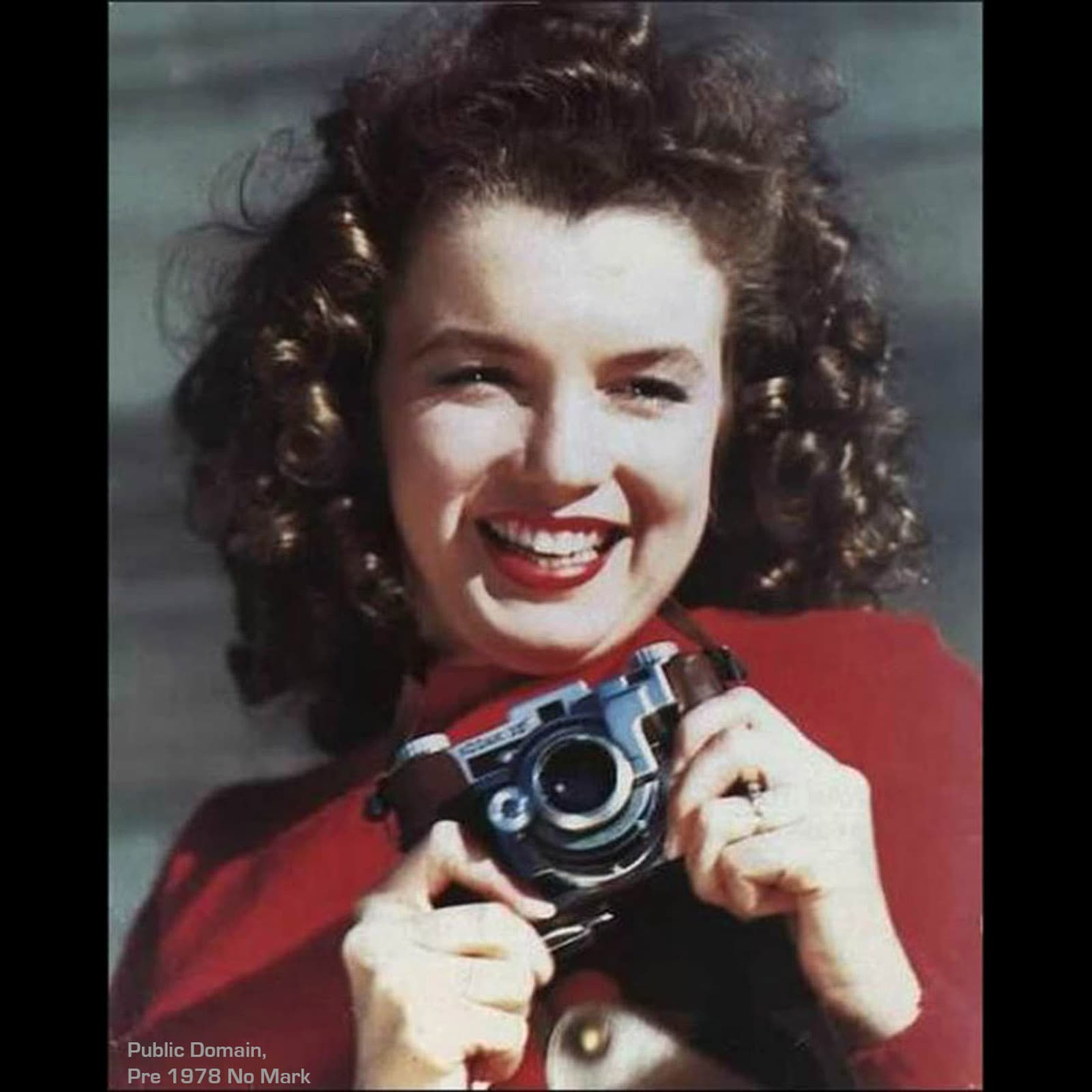 Norma Jeane Baker (later known as Marilyn Monroe)- posing with a Kodak Range Finder 35mm camera.