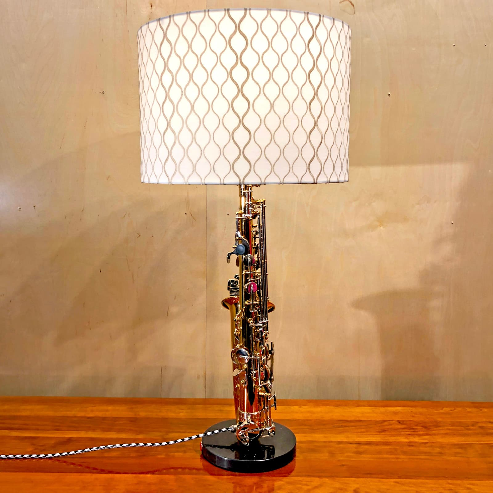 Side view of Rosie's Workshop original saxaphone side table light. All parts are UL component listed (c UR us) for United States and Canada.