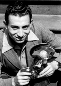 Tony Vaccaro holding an Argus C-3 brick camera with flash.