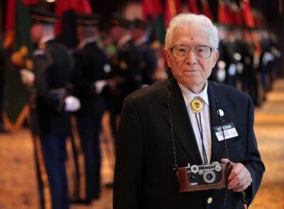 Older Tony Vaccaro holding original Argus C-3 brick camera.
