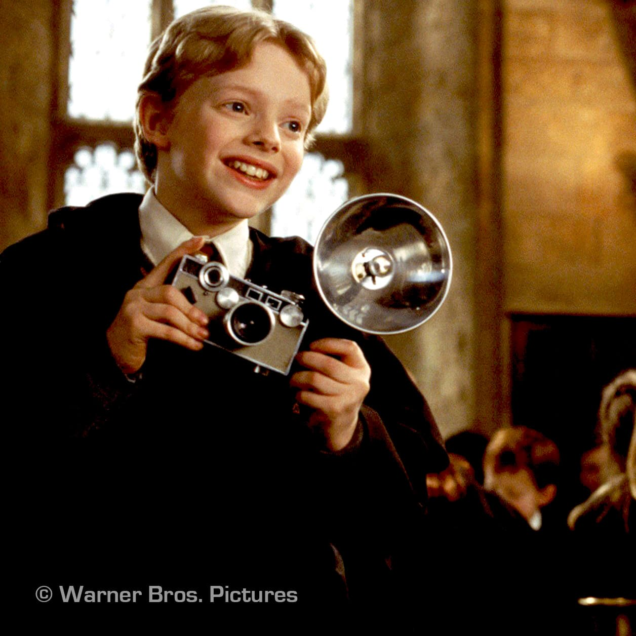 Picture of Colin Creevey from Harry Potter with Argus camera and flash. Copyright Warner Bros.