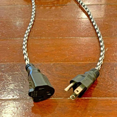 View of 3 prong end of Rosie's Workshop original retro inspired fabric extension cord. Heavy-duty, grounded, 3-prong plug, 15-foot length. UL listed (c UR us) for United States and Canada.