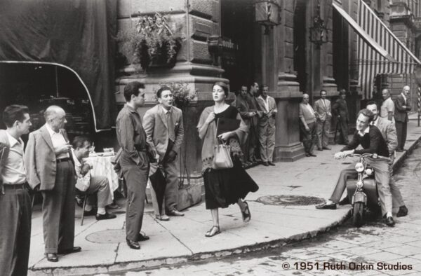 Ruth Orkin one of the pioneers of street photography, her most famous photograph, An American Girl in Italy, 1951 features a crowded street in post-war Italy.