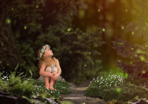 Image for blog - The Magic of Memories. A blonde swedish girl is watching fireflies. Purchased from iStock.com.