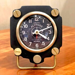 Front view of Rosie's Workshop Altimeter Alarm Clock in black finish. A wonderful retro alarm clock design based on altimeters from WWII fighter planes.