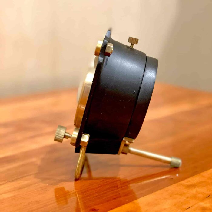 Side view of Rosie's Workshop Altimeter Alarm Clock in black finish. A wonderful retro alarm clock design based on altimeters from WWII fighter planes.