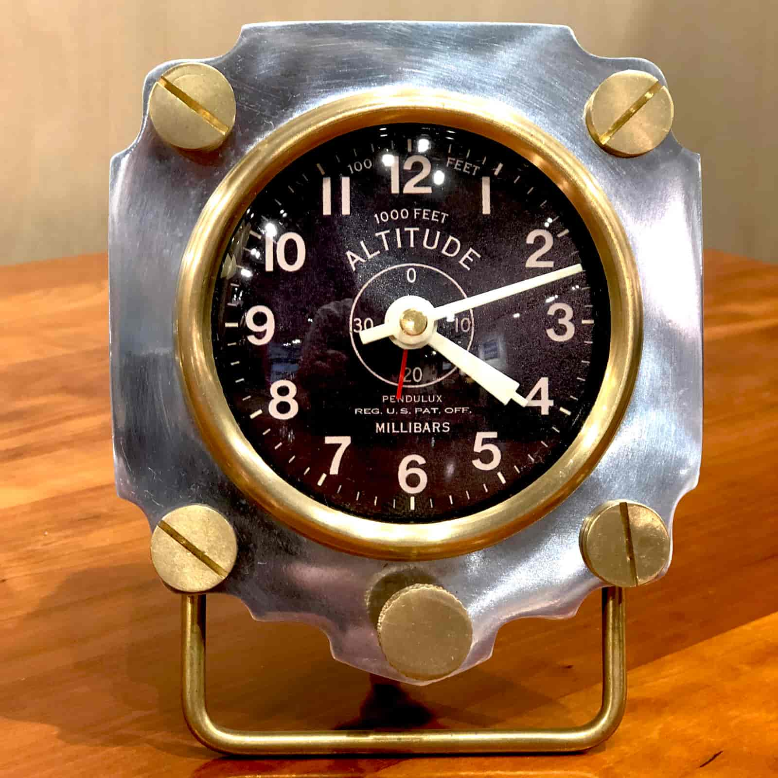 Front view of Rosie's Workshop Altimeter Alarm Clock in chrome finish. A wonderful retro alarm clock design based on altimeters from WWII fighter planes.