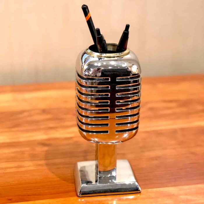 Close up view of Rosie's Workshop Microphone chrome pencil holder and phone stand are based on the Shure Brothers 55D microphone made famous by a young Elvis Presley while on tour in 1955 – 1957.