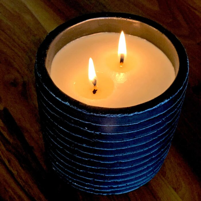 Close-up view of Rosie's Workshop medium black lit Story Candle. Hand crafted, 100% pure soy wax, cosmetic grade scents, the finest cotton made wicks. Storytelling through smell & fire.