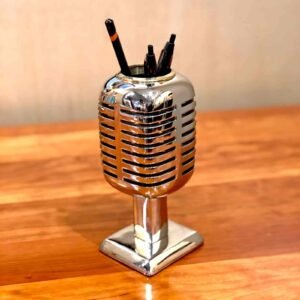 Side view of Rosie's Workshop Microphone chrome pencil holder and phone stand are based on the Shure Brothers 55D microphone made famous by a young Elvis Presley while on tour in 1955 – 1957.