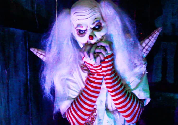 Scary Clown stock image for blog article - When Did Haunted Houses Begin.