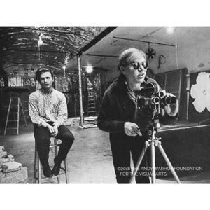 Picture of Andy Warhol using a Bolex camera at the Factory. Image Copyright 2018 the Andy Warhol Foundation for the Visual Arts.
