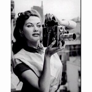 Yvonne De Carlo with a Bolex H16 movie camera.