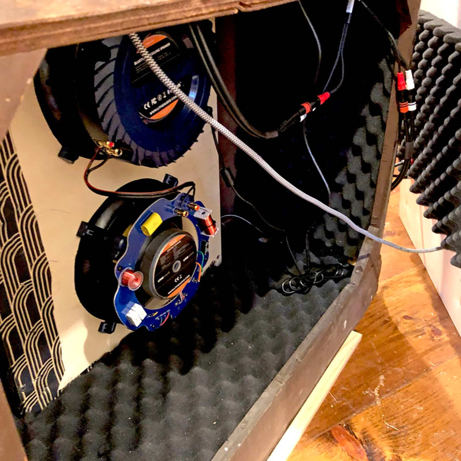 Inside view of Rosie's Workshop edition vintage floor radio with modern technology. We outfit the radio with a high-end Bluetooth or Wi-Fi audio system. We apply professional grade acoustic foam and baffles to create perfect sound in a sealed speaker box within the original cabinet.