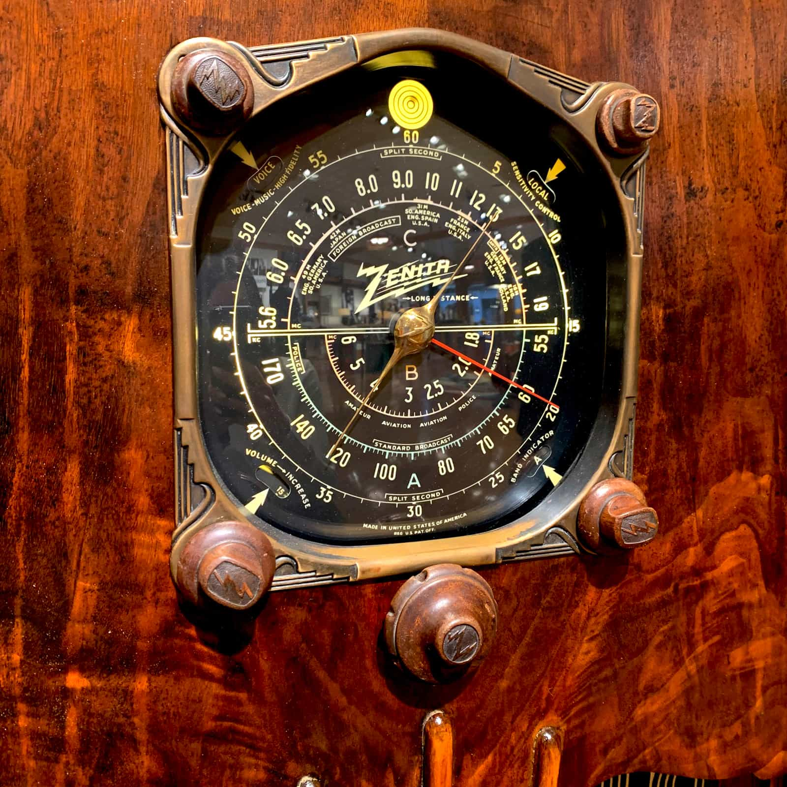 Up close view of dial of Rosie's Workshop Zenith 1930s vintage floor radio with modern technology. We outfit the radio with a high-end Bluetooth 5 audio system.