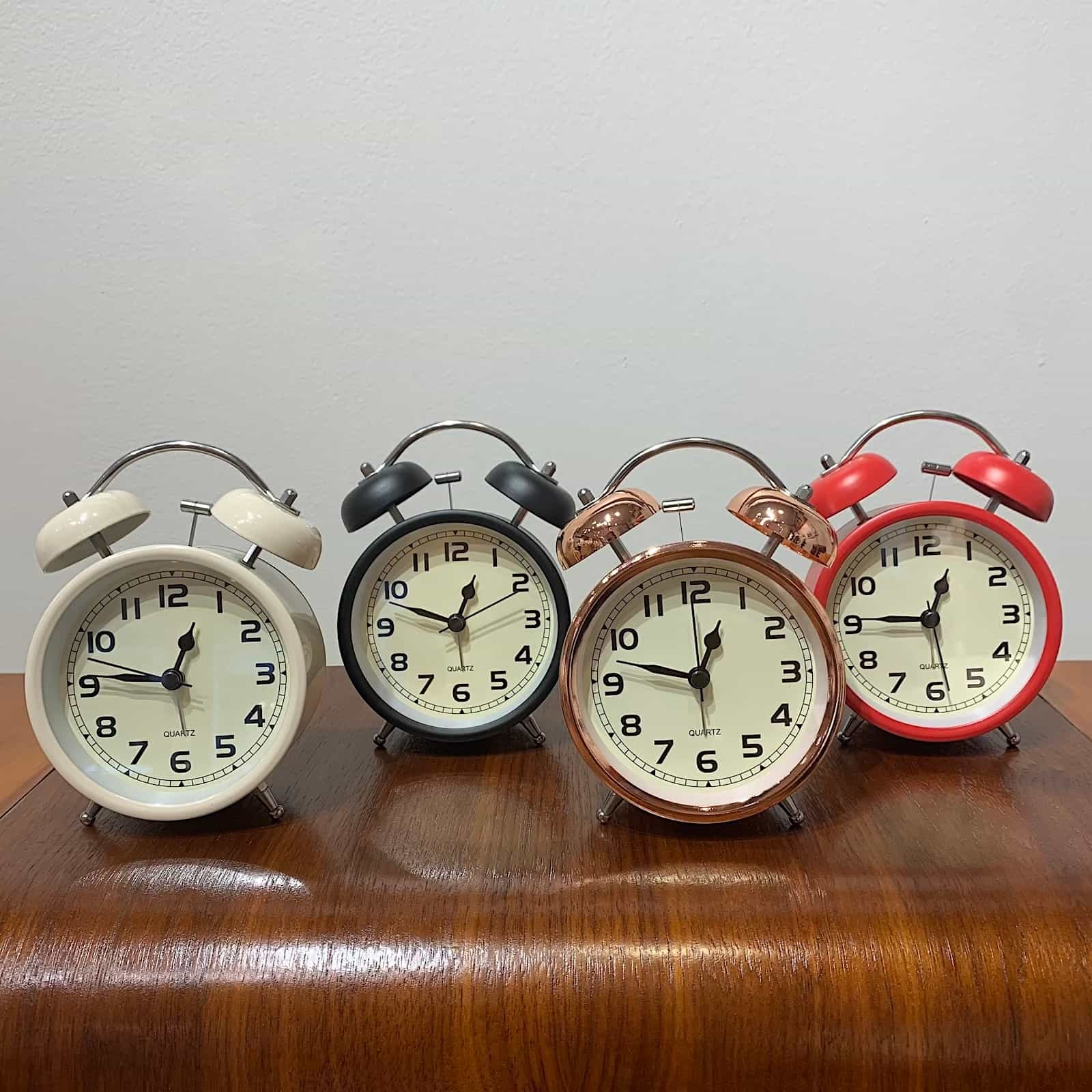 Front View - Rosie's cool retro alarm clock allows you to put the phone away and get a good night's sleep. In four colors black, red, white and rose gold.