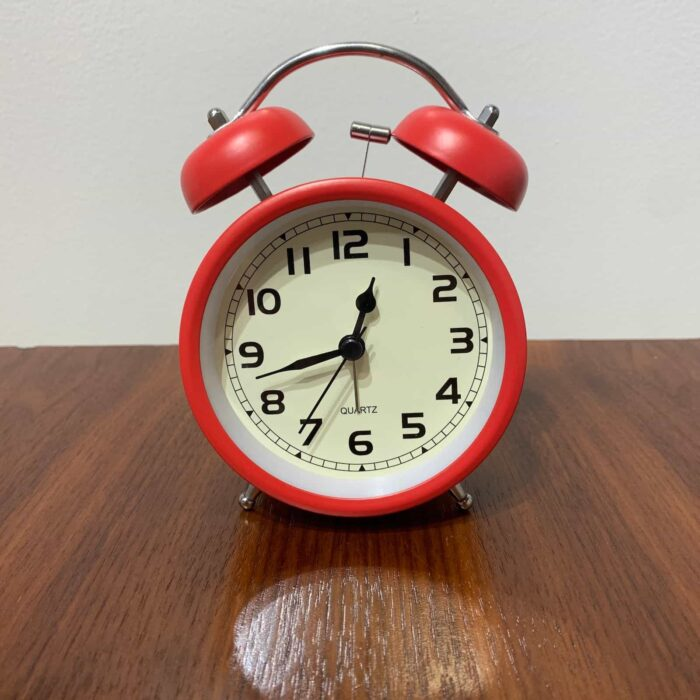 Front View - Rosie's cool retro alarm clock in red.